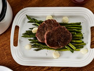 Sous Vide Tenderloin Steaks with Asparagus and Onions