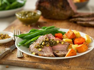 Herb-Crusted Beef Roast with Pistachio-Leek Pesto