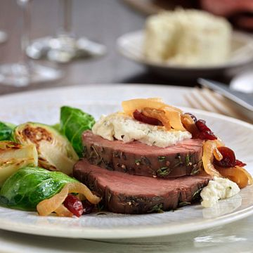 Tenderloin Roast with Wine-Braised Onions and Herb Cheese