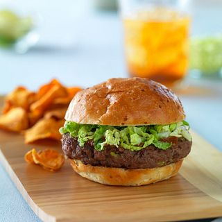 This unique burger is topped with the flavors of Thailand: peanut butter, lime juice and hoisin with the crunch of cabbage.