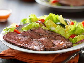 Caribbean Jerk Tri-Tip Over Basil Lime Salad