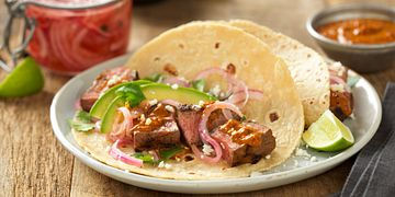 Grilled Adobo Beef Steak Tacos with Creamy Chipotle Salsa and Tequila Pickled Red Onions