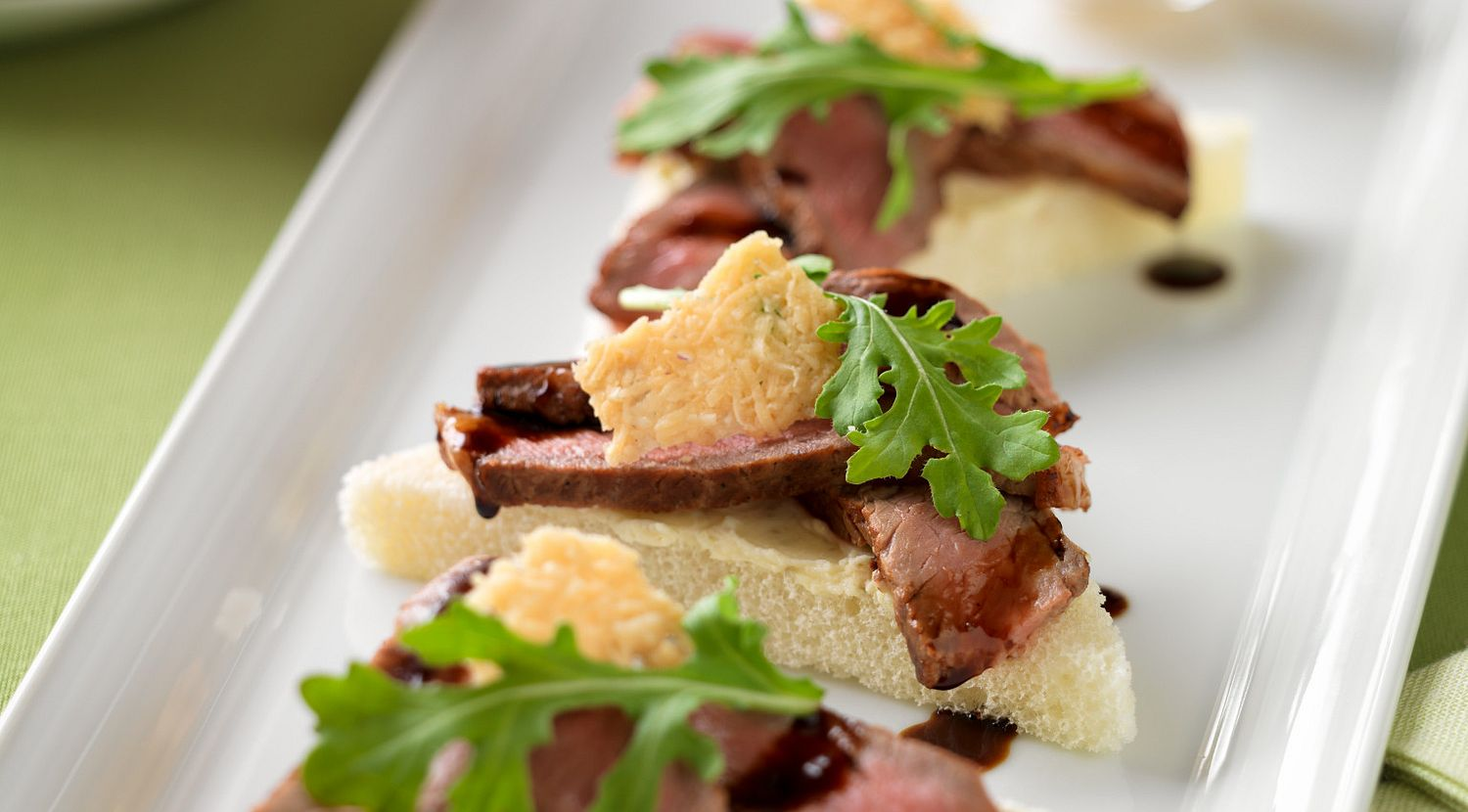 Beef Crostini with Parmesan Crisps and Balsamic Drizzle