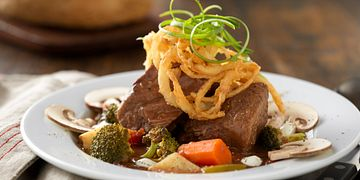 Slow Cooked Pot Roast Stew with Roasted Vegetables and Lemon Crema