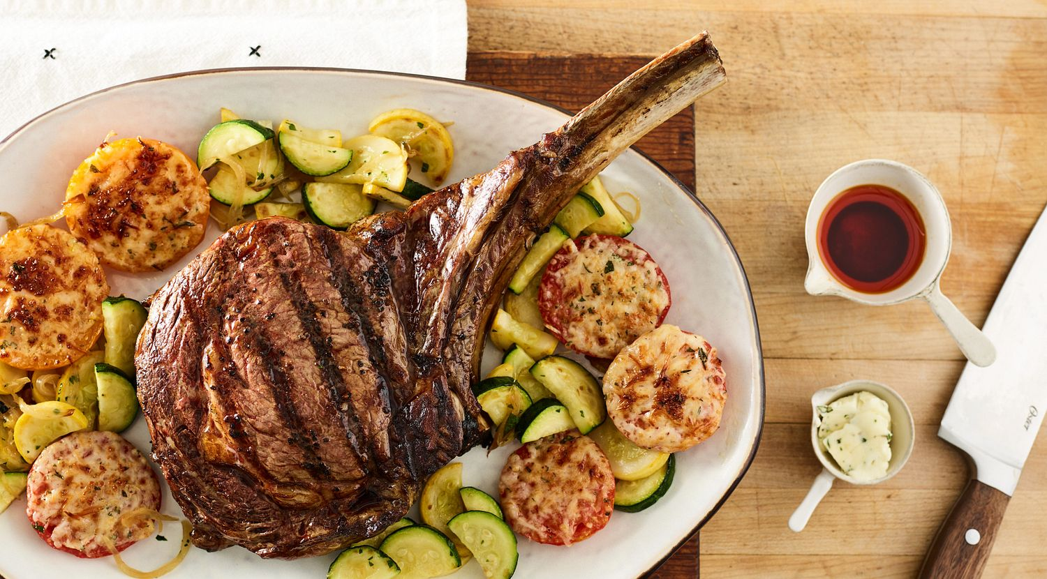 Grilled Beef Ribeye Steak with Parmesan Tomatoes and Squash