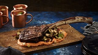 Tomahawk Steak with Grilled Brussels Sprouts and Sweet Potato Puree