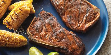 Smoky Grilled Strip Steaks with Mexican-Style Corn