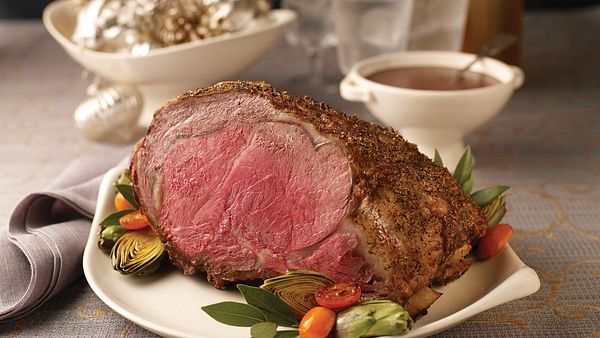 herb-seasoned-rib-roast-with-red-wine-pan-sauce-slice-out-horizontal
