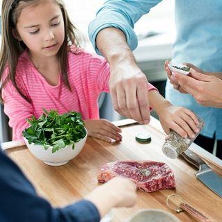 Family prepping steak