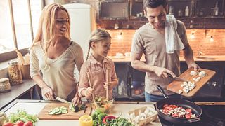 Family cooking together stock