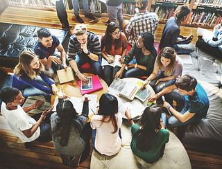 Teenagers studying in a library
