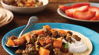 Ground Beef and sweet potato chunks get wrapped up in a whole-wheat tortilla.