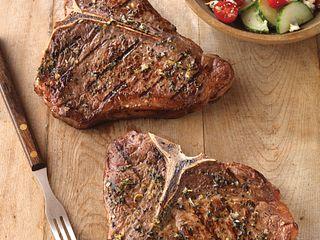 Greek-Seasoned T-Bone Steaks with Cucumber and Tomato Salad