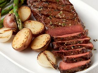 Tender Pepper-Rubbed Strip Steaks with Grilled Vegetable Trio