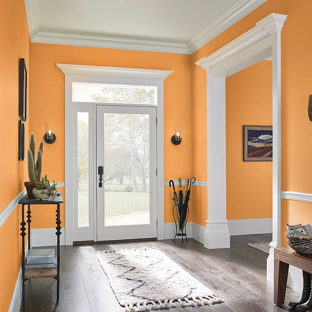 Foyer painted in BITTERSWEET ORANGE