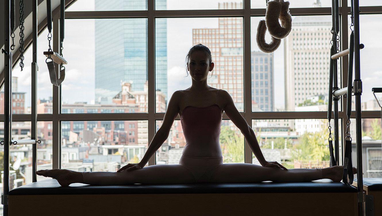 Former Boston Ballet dancer in a split in the PT room. photo by Ian Travis Bernard