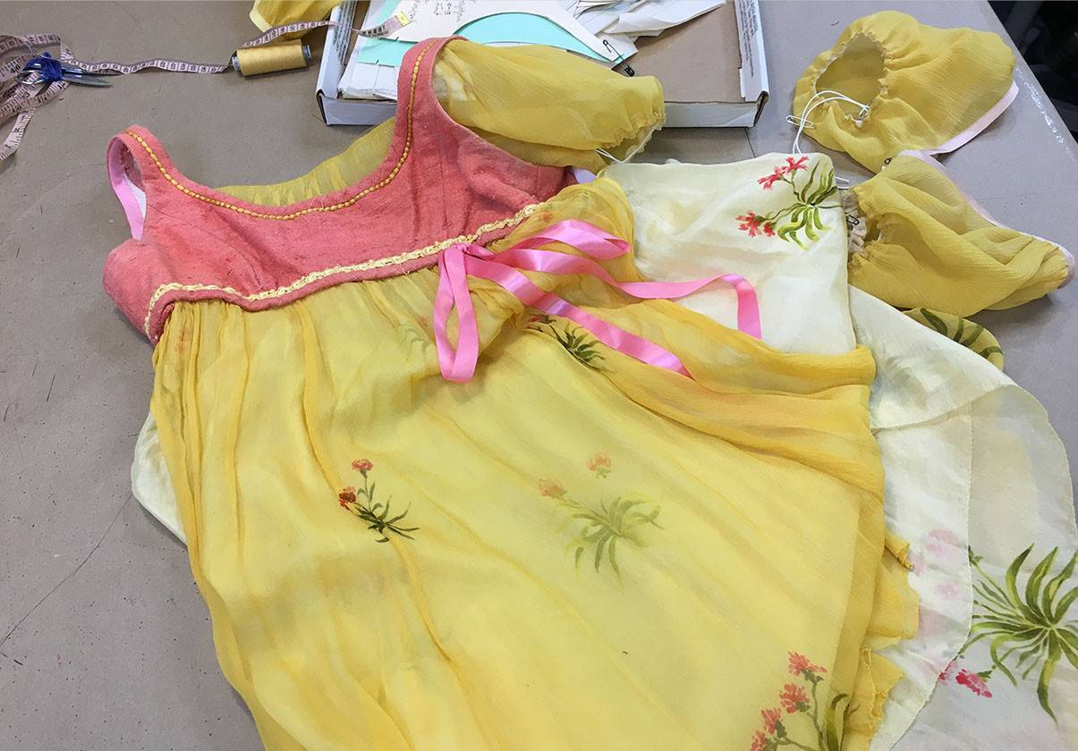 Juliet's first dress features hand painted flowers on silk.