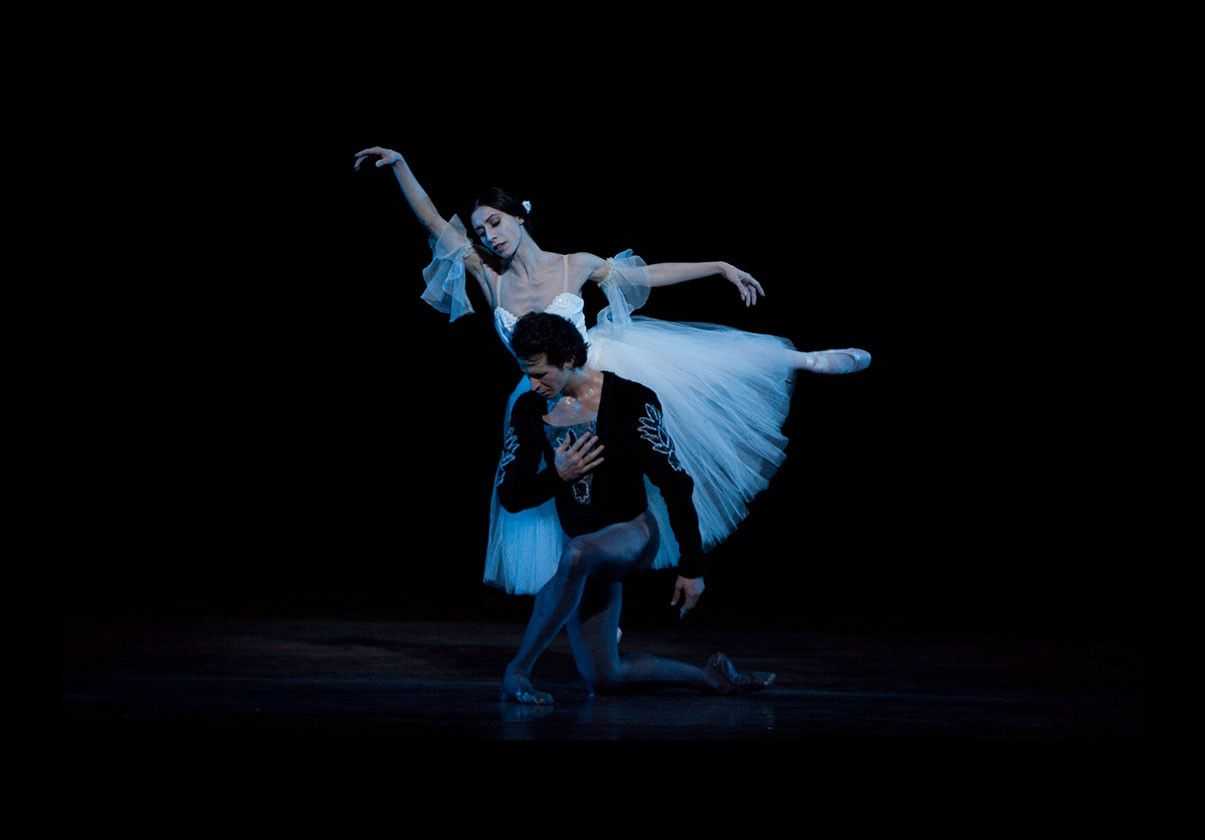 Erica Cornejo as Giselle stands over Nelson Madrigal as Albrecht in Act II of Giselle. Photo by Rosalie O'Connor