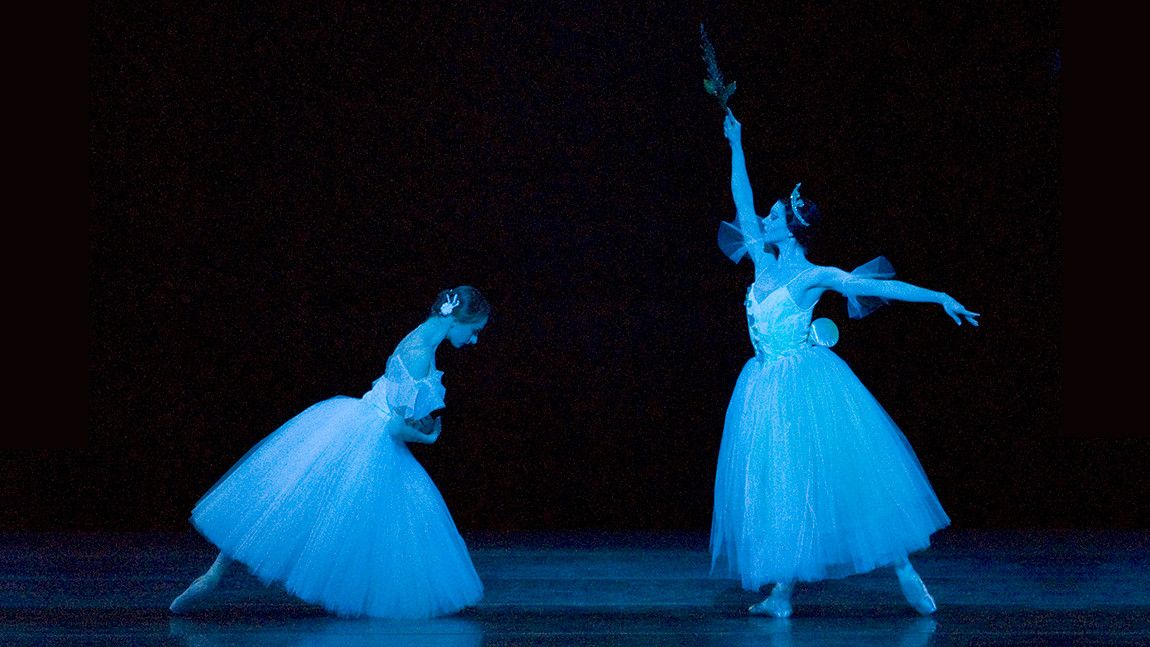 Larissa Ponomarenko as the character Giselle kneeling infront of Kathleen Breen Combes as the character Mithra, Queen of the Wylies from the ballet Giselle photographed by Gene Schiavone.