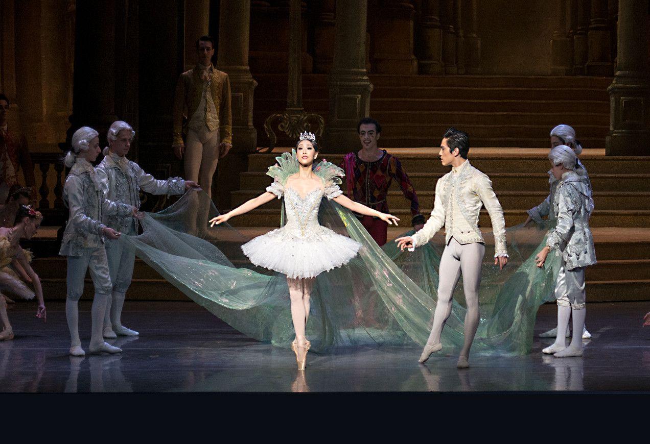 Jeffrey Cirio and Misa Kuranaga with artists of Boston Ballet in Sir Frederick Ashton's Cinderella by Gene Schiavone.
