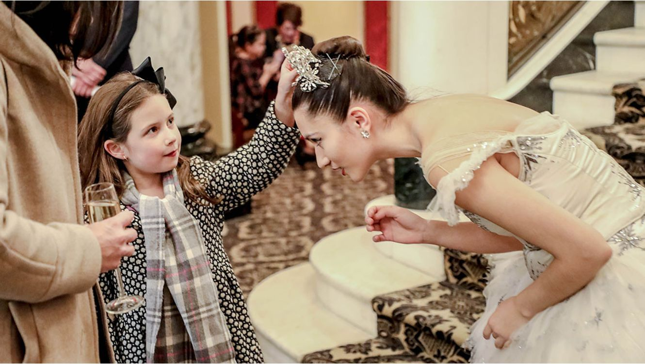 Child with young dancer in snowflake tutu from The Nutcracker