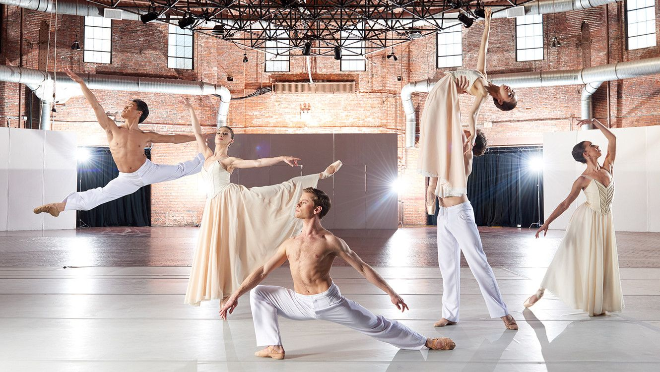 Boston Ballet dancers dressed in white and cream photographed at the Cyclorama by Rachel Neville