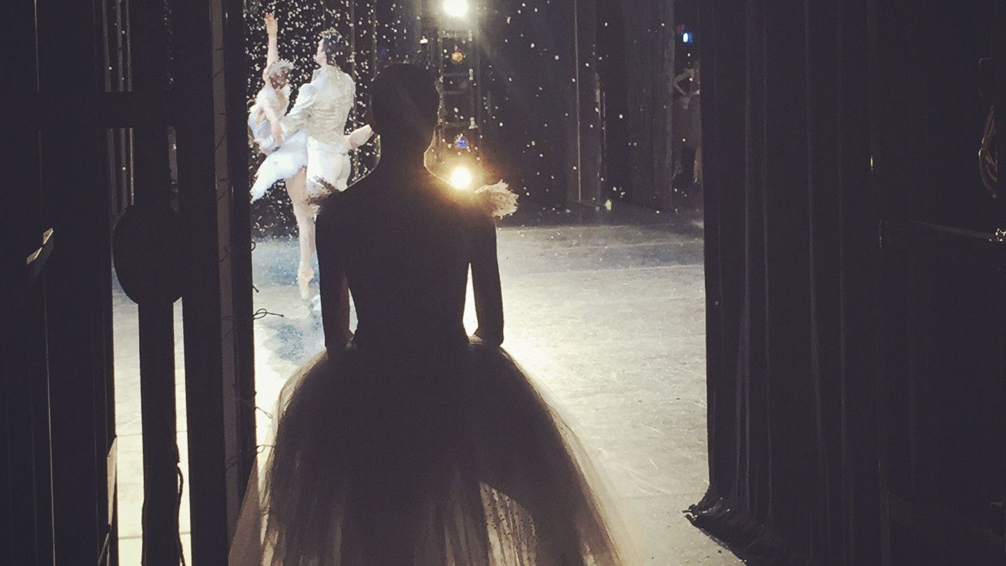 Dancer watches the snow scene from the wings.