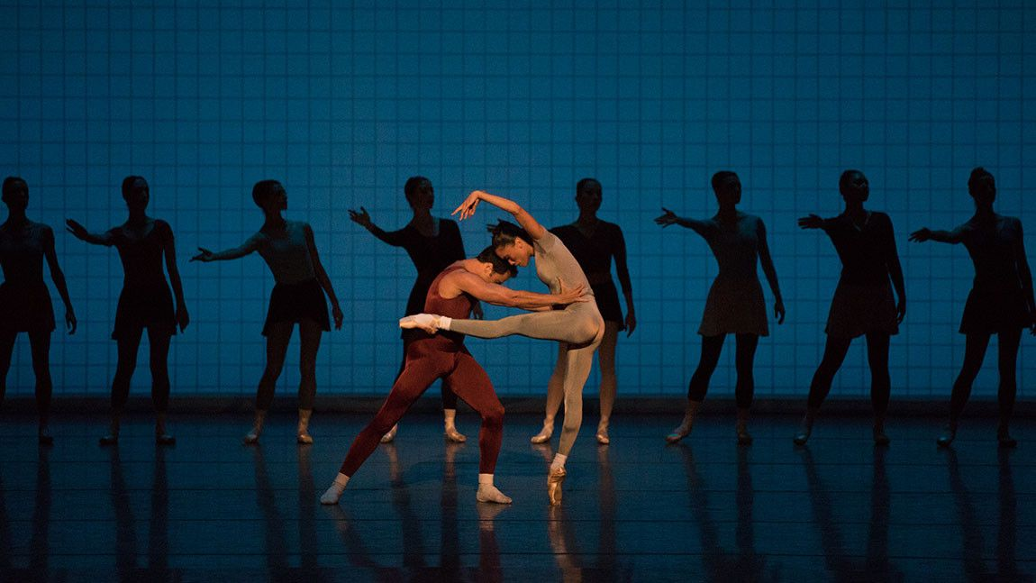 Lia Cirio and Paulo Arrais pictured in front of image dancing in Glass Pieces, choreography by Jerome Robbins. Photographed by Rosalie O'Connor