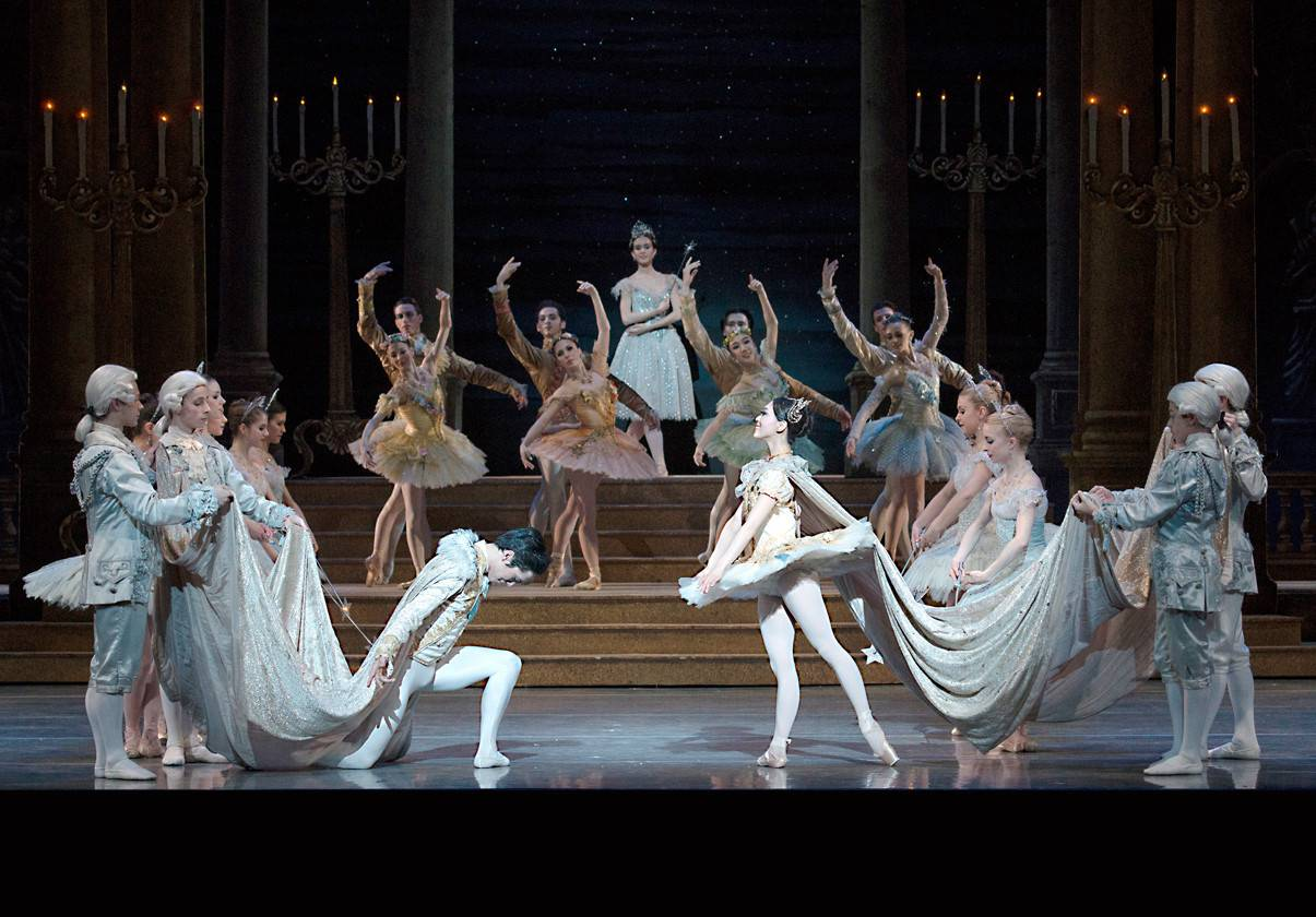 Jeffrey Cirio and Misa Kuranaga with artists of Boston Ballet in Sir Frederick Ashton's Cinderella by Gene Schiavone.