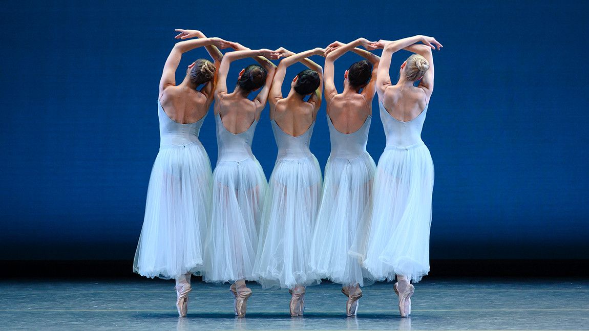 Five Boston Ballet dancers on stage in George Balanchine's Serenade photographed by Marty Sohl