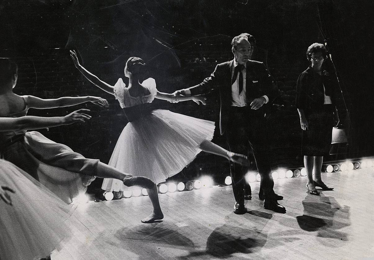 E. Virginia Williams and Gorge Balanchine on stage with Boston Ballet dancers during a rehearsal of Scotch Symphony.