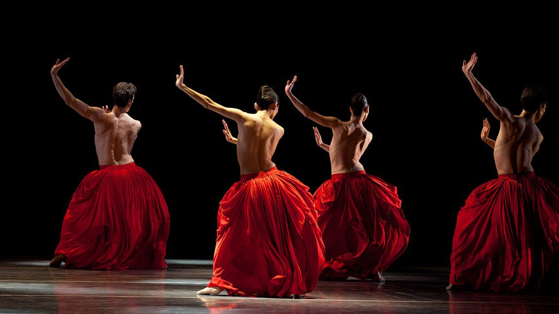 Boston Ballet dancers onstage in large red skirts in Jiří Kylián's Bella Figura photographed by Rosalie O'Connor