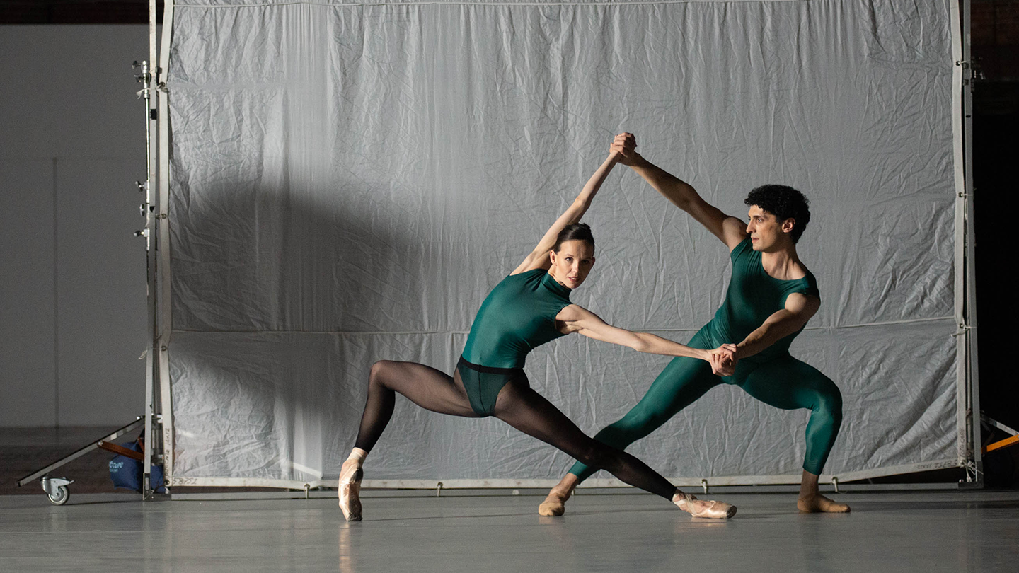Vika Kapitonova & Lasha Khozashvili in green leotards image taken at the Cyclorama. Photo by Brooke Trisolini