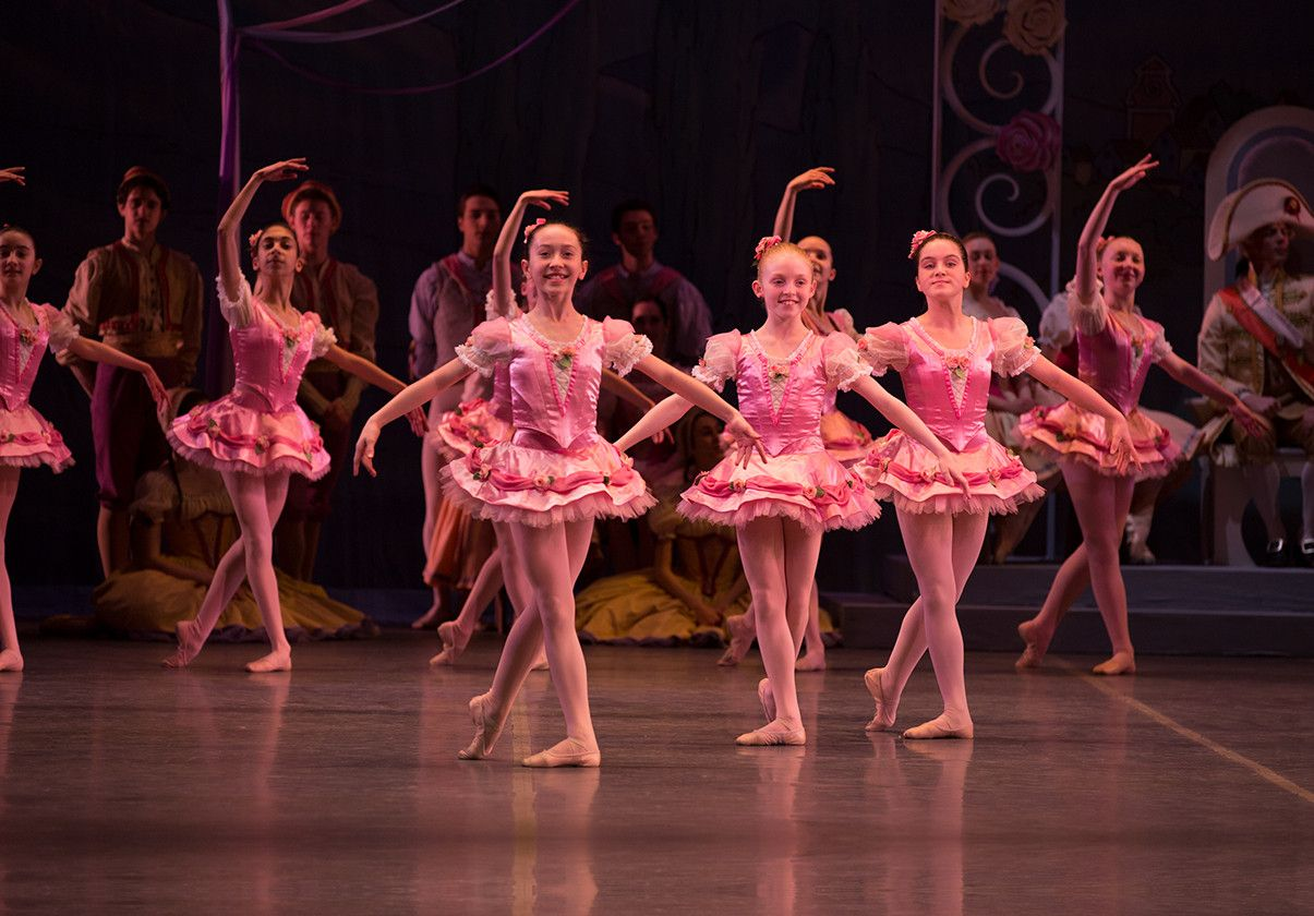 Boston Ballet School students in pink tutus on stage in the production of George Balanchine's Coppelia.
