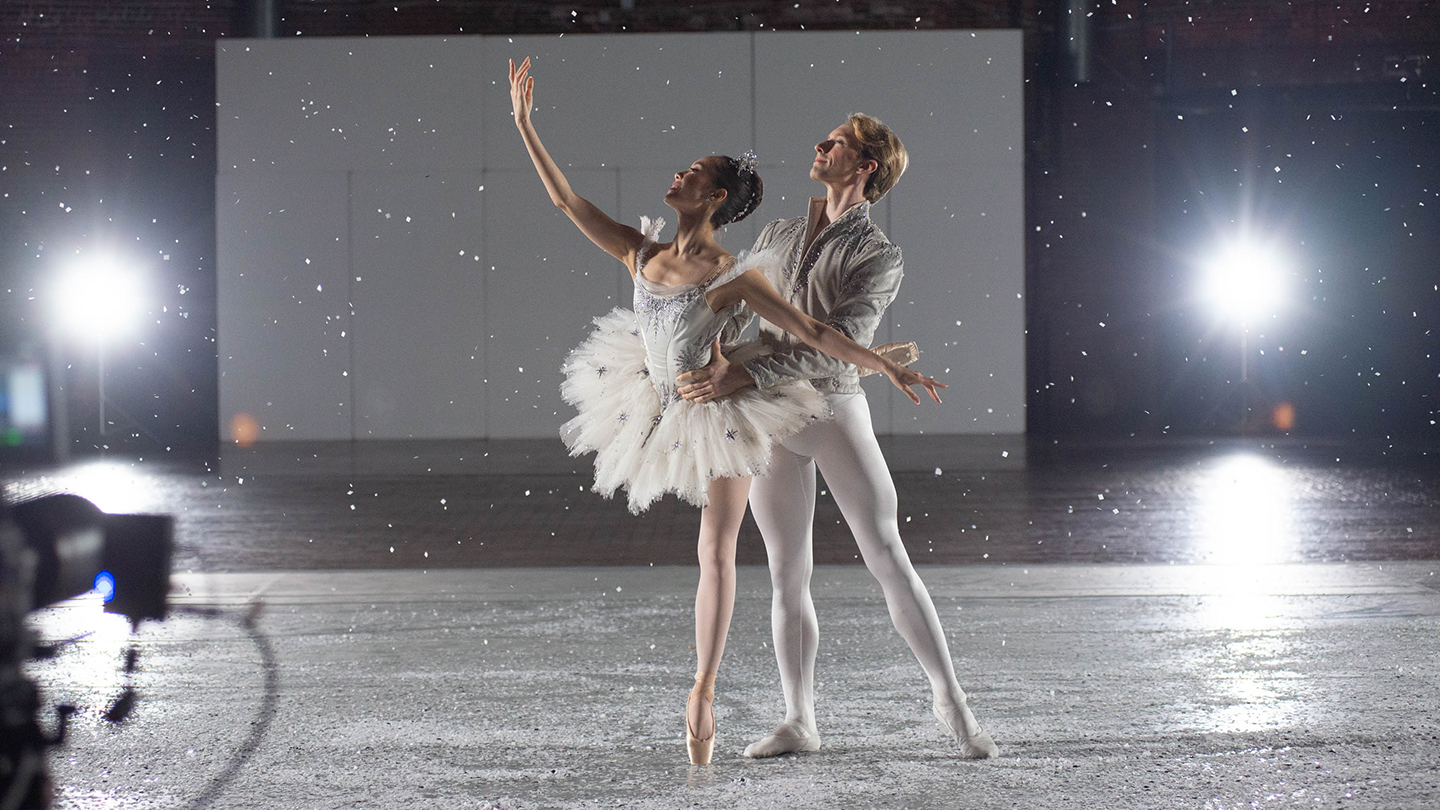 Seo Hye Han and Patrick Yocum in an Snow Scene image taken at the Cyclorama. Photo by Brooke Trisolini