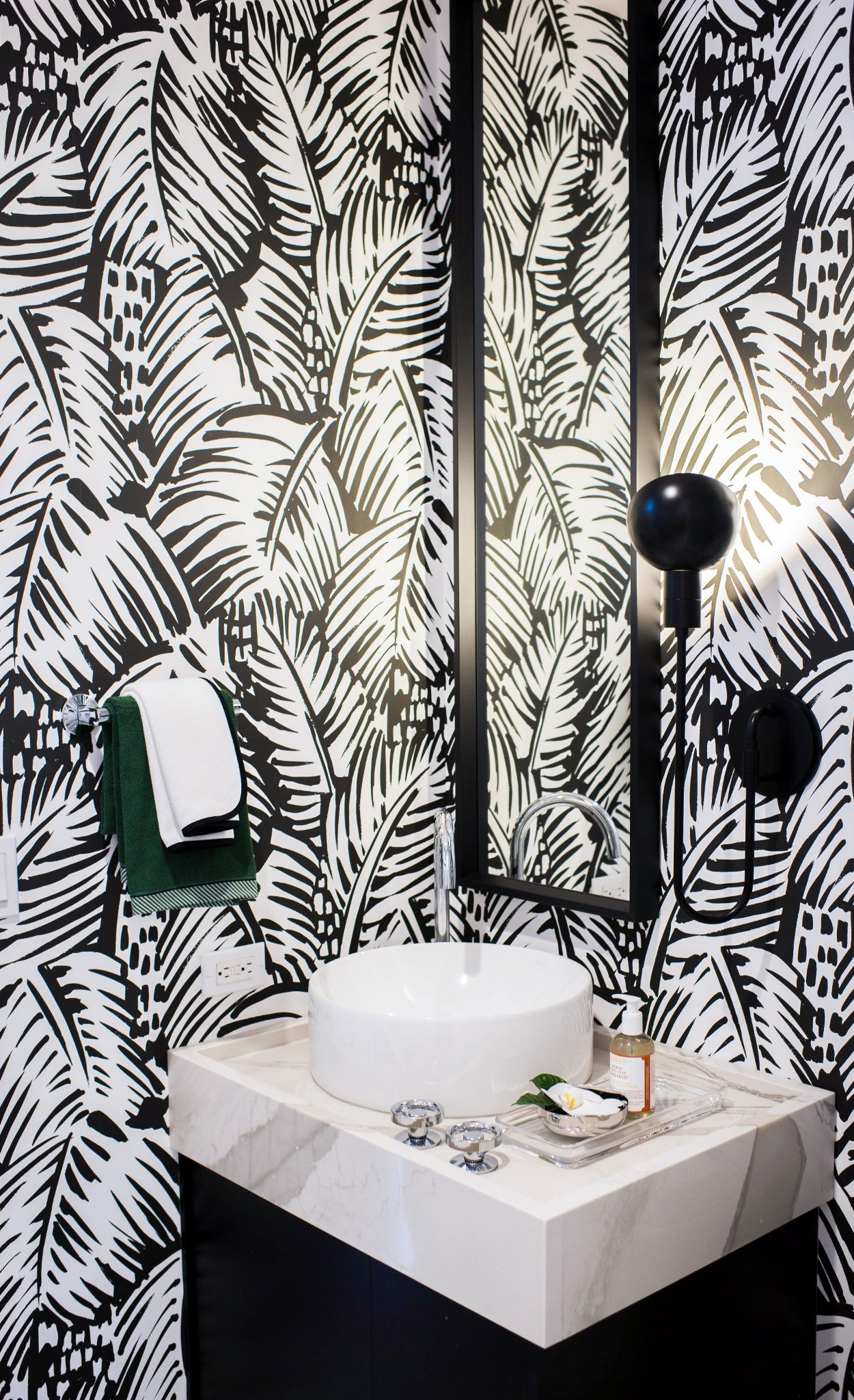 Bold wallpaper creates a statement in this powder room with Brittanicca Warm.
