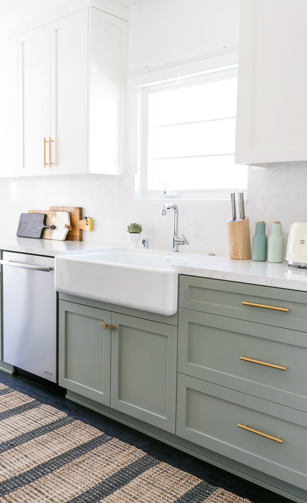 Green cabinets paired with brass accents and Cambria Torquay countertops and backsplash.