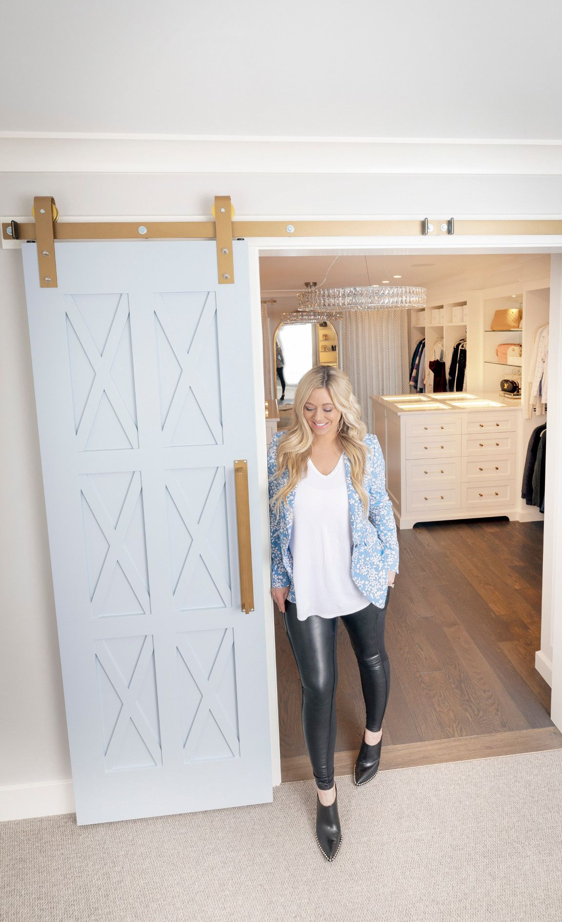 Carly Zucker pictured in the doorway to her closet featuring Cambria Delgatie.