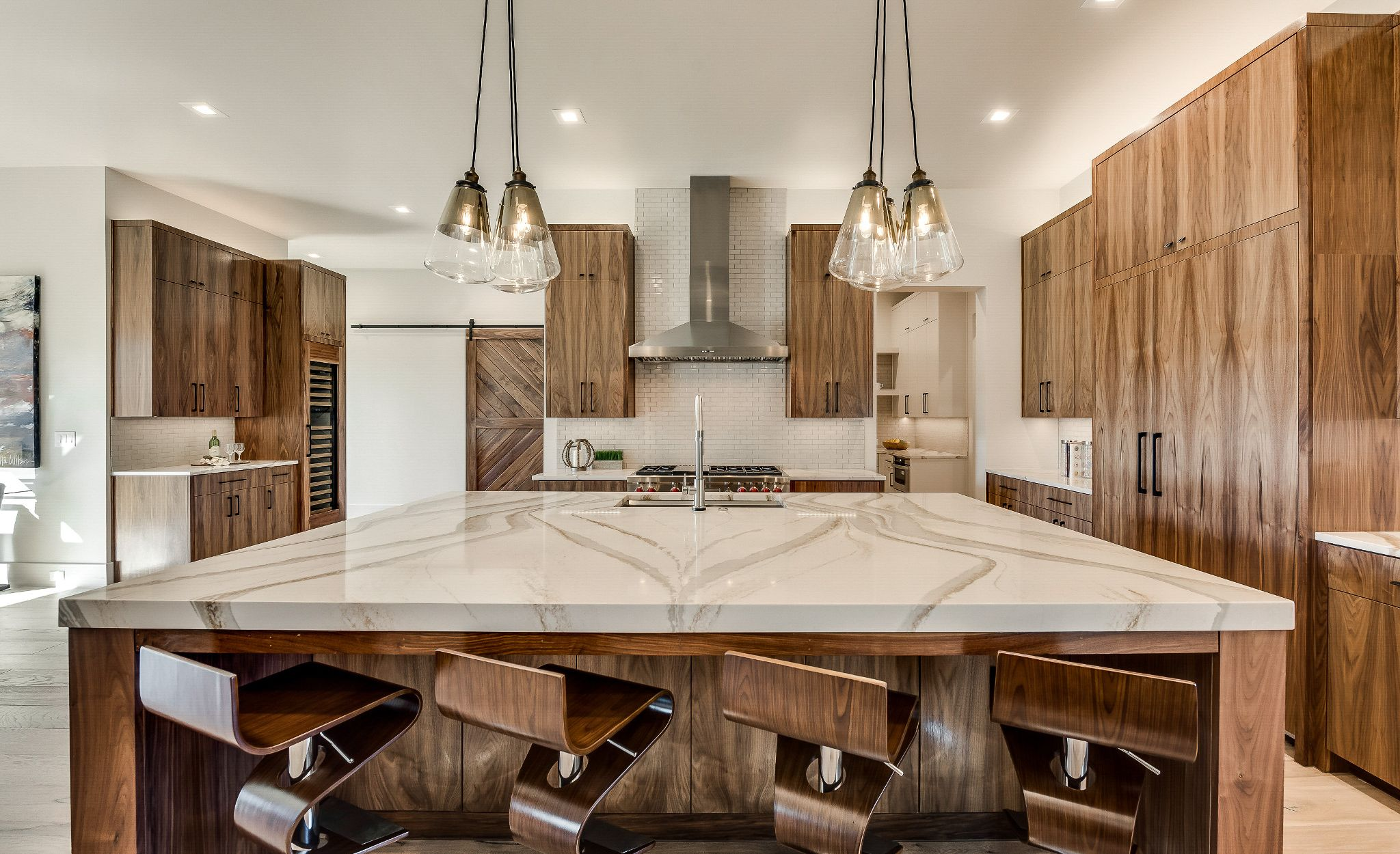 Gold marble-look quartz countertops paired with natural wood cabinets.