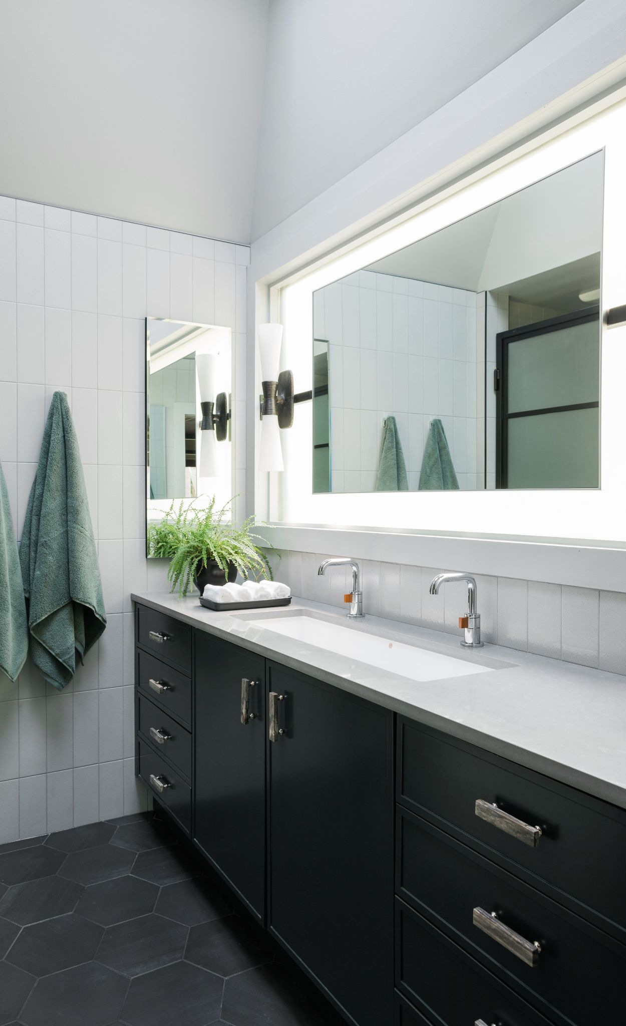 Create a masculine master bath wit Cambria Carrick and gray tones.