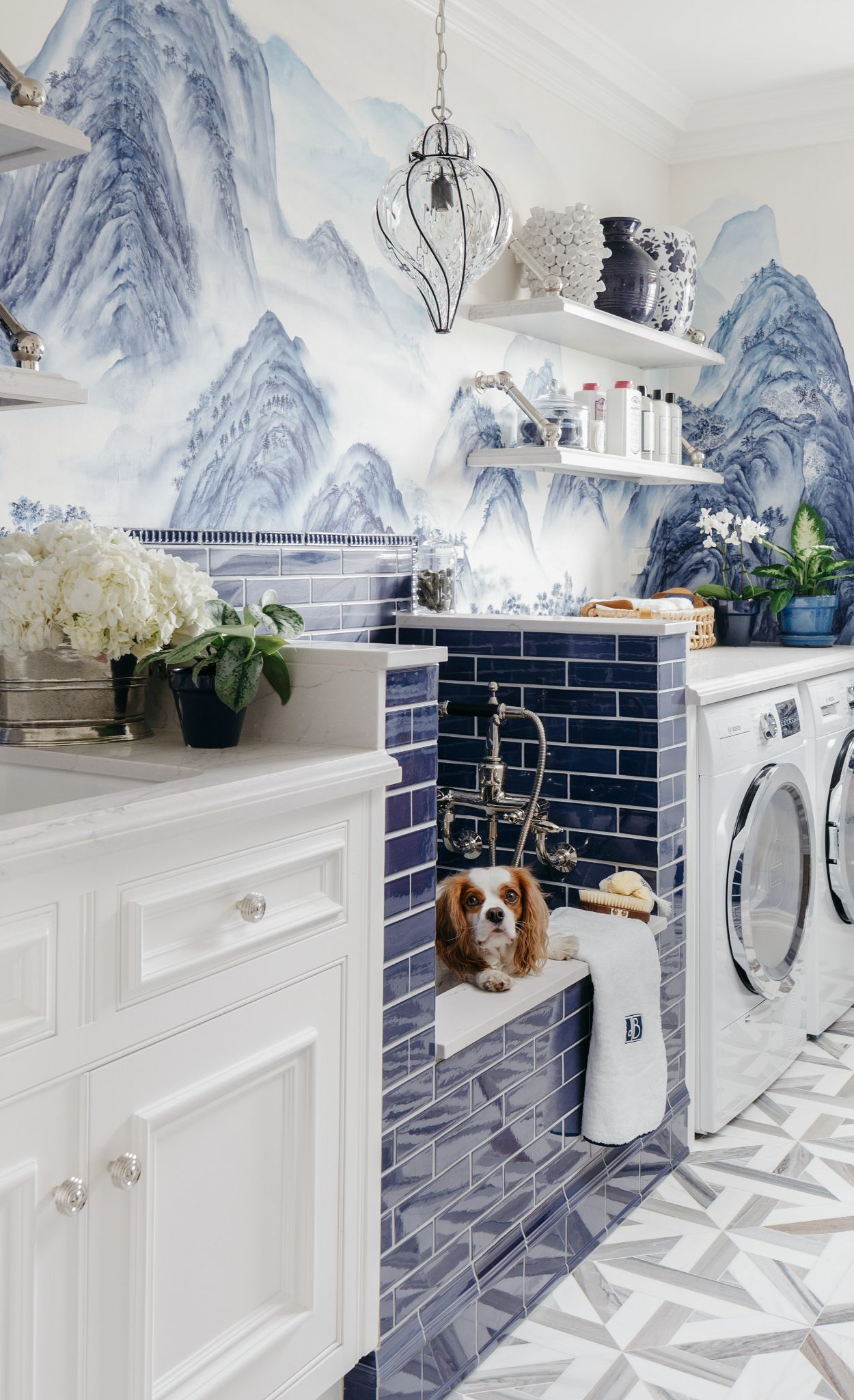 Laundry room with blue tile and mural wallpaper with Cambria Ella countertops.