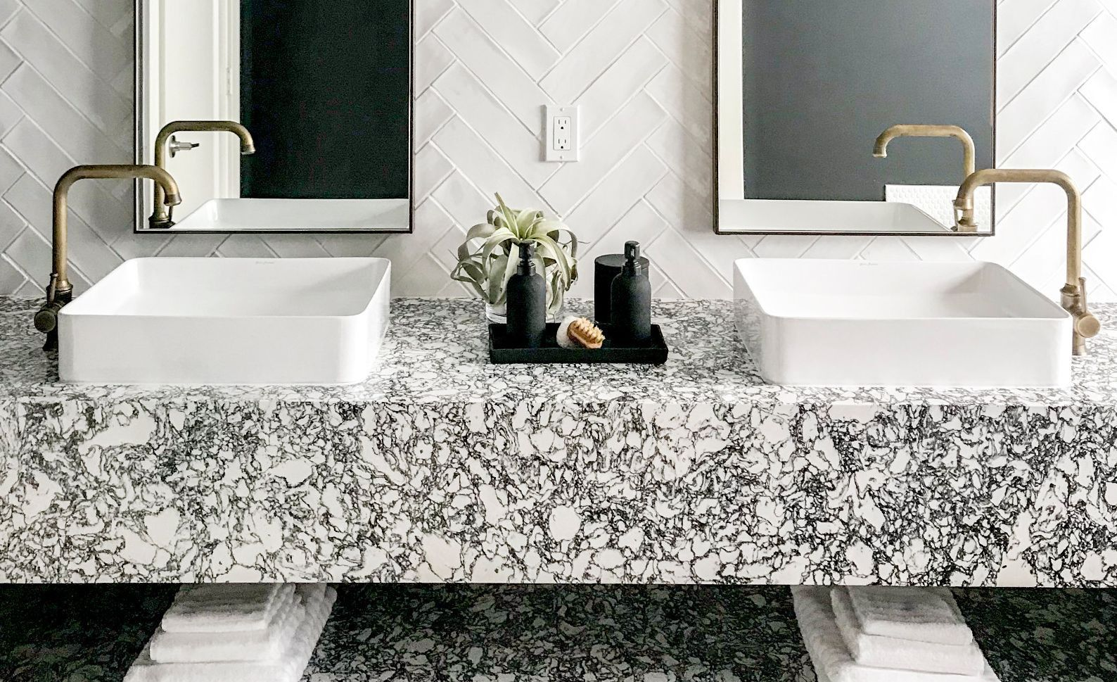 High-contrast black and white floating vanity in Cambria Rose Bay.