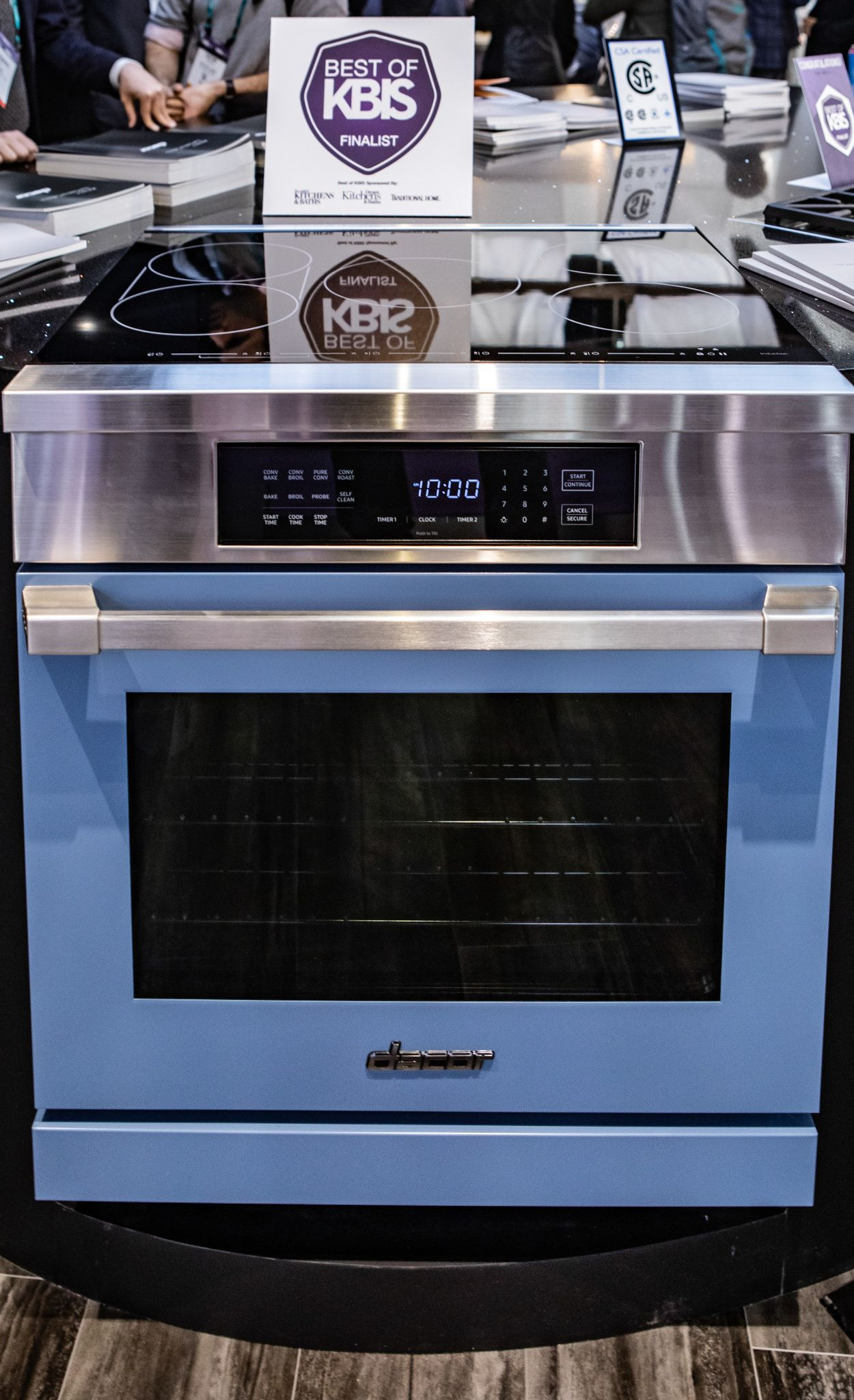 Create a custom kitchen with colorful appliances like this blue oven.