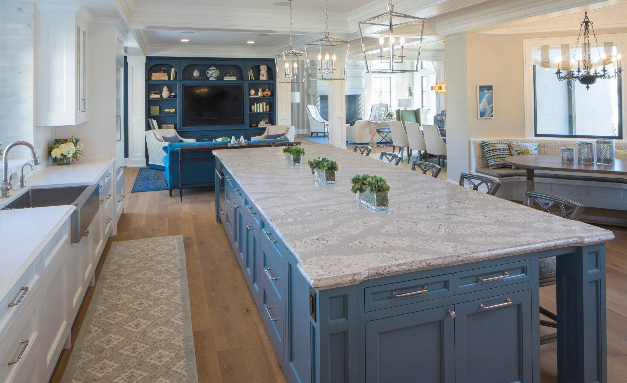 Blue-gray kitchen island with Cambria Summerhill countertops.