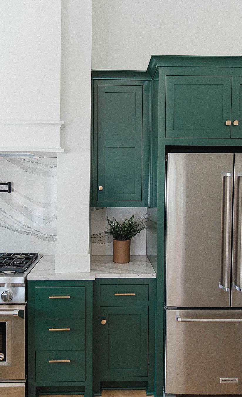 Green farmhouse kitchen with Brittanicca™ countertops.