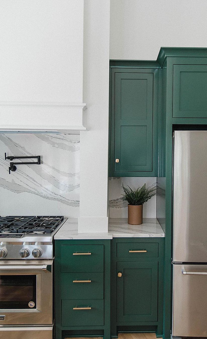 Green farmhouse kitchen with Brittanicca™ countertops.