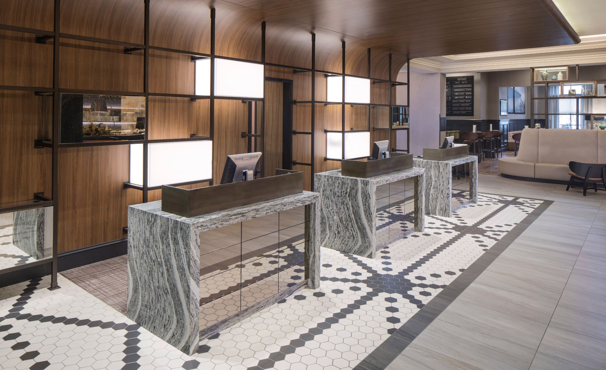 Hotel reception desk stations featuring waterfall-edge Cambria Roxwell countertops at Renaissance Minneapolis Hotel.