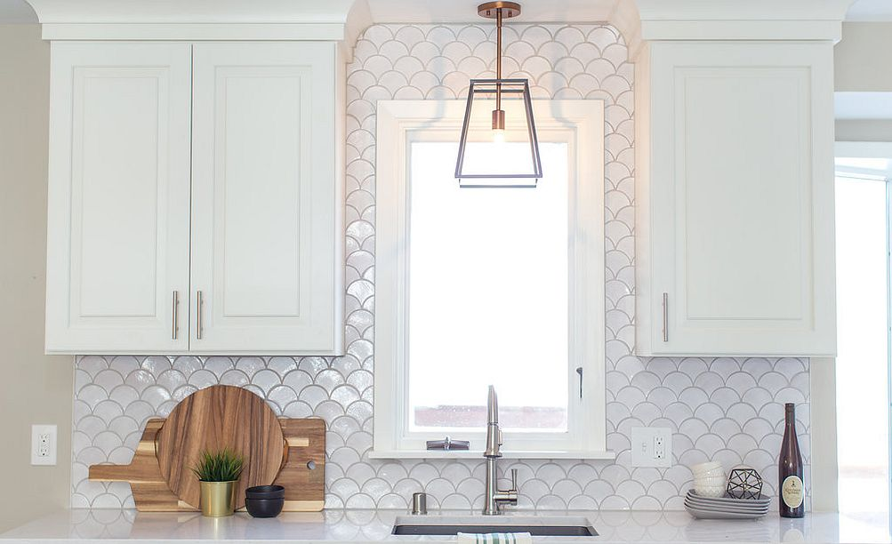 Add character with mermaid tile and Cambria Swanbridge countertops.