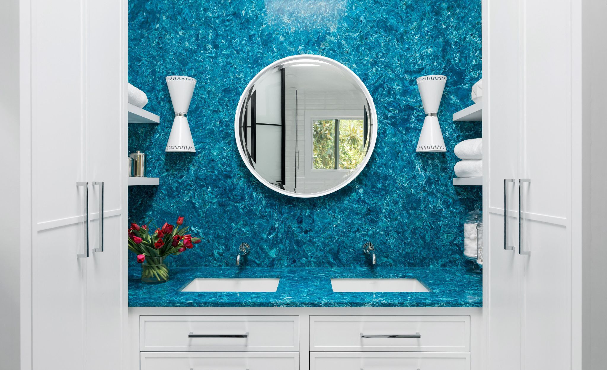 Cambria Skye is a mesmerizing bathroom vanity backsplash in this blue bathroom.