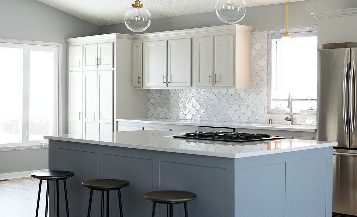 Pair Cambria Swanbridge, mermaid tile, and gray cabinetry to create a family-friendly kitchen.